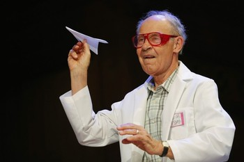 Herschbach, winner of the 1986 Nobel Prize for Chemistry, throws a paper airplane during the 23rd First Annual Ig Nobel Prize ceremony at Harvard University in Cambridge