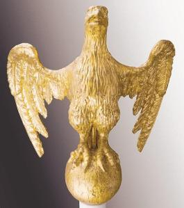 The eagle is a classic symbol shared by ancient Rome and America. The American eagle on display in the exhibition is carved from gilt wood. It was made in 1804 by Samuel McIntire, an important early American architect. Courtesy Lynn Museum and Historical Society.